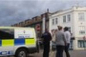 police dealing with man on roof at lemon quay in truro city...