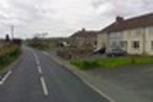 Vehicle left embedded in garden wall on Prestleigh Road,...