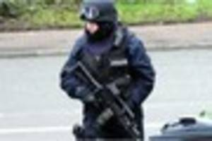 a woman was stunned when armed police stormed her home and found...