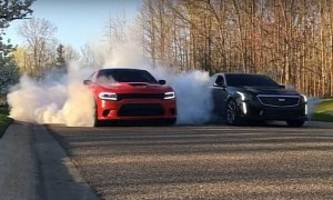 charger hellcat fights cadillac cts-v on winter tires in brutal burnout standoff