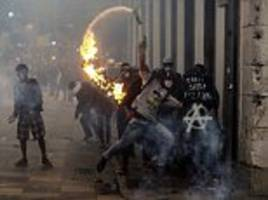 Brazilians clash with police during national strike