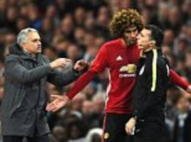 marouane fellaini was restrained at the end of derby