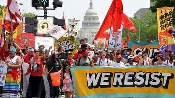 Anti-Trump climate change march draws thousands in US