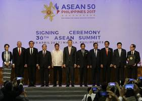 asean softens tone against china