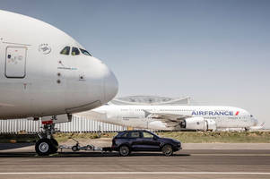 watch a porsche cayenne set a record by towing an airbus a380 jet airliner