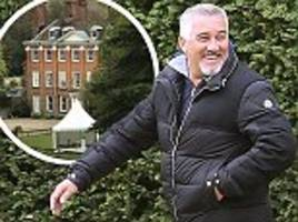gbbo's paul hollywood flashes smile while filming