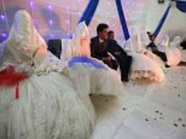 afghanistani wedding ceremony sees 34 couples tie the knot