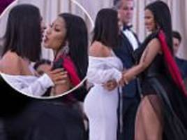 nicki minaj greets kim kardashian with a kiss at met gala