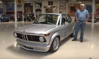 jay leno drives bmw 2002 with e30 m3 engine, calls it a perfect restomod