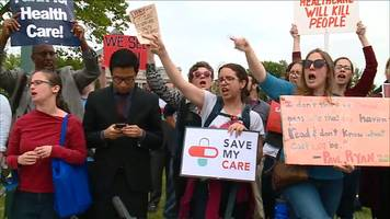 protesters yell 'shame' at politicians over healthcare bill