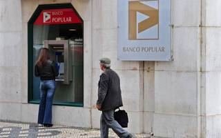 banco popular posts €137m loss and ups provisions on toxic assets