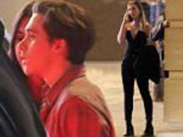 brooklyn beckham flirts outside london's toy room