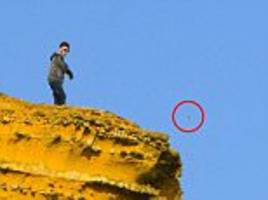teenagers hurl rocks from the top of 'broadchurch cliffs'