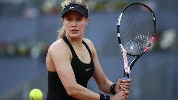 bouchard sees off sharapova in epic to reach madrid open third round