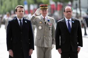 the latest: macron, hollande make first joint appearance