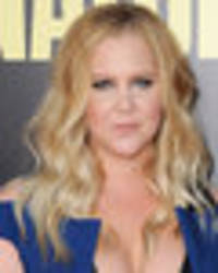 amy schumer joined by uninvited guest during naked bathtub reveal