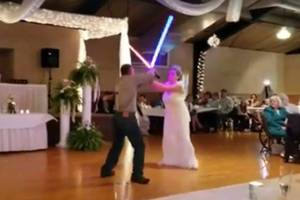watch newlyweds have a light saber battle instead of first dance (video)