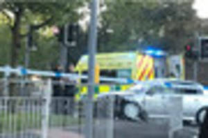 one taken to hospital after car crashes into barriers on major...