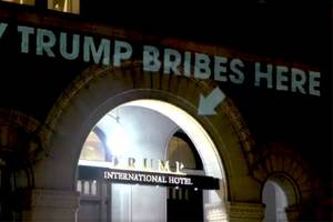 Artist Projects Emoluments Clause on Trump's DC Hotel: 'Pay Trump Bribes Here' (Video)