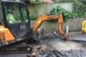 Water floods Exeter road after water main bursts