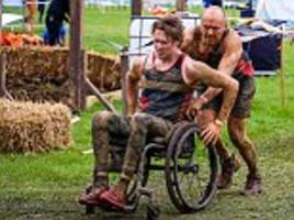 Determined father tries to help son in Tough Mudder event