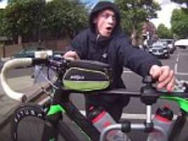Moment would-be thief tries to steal bike from back of car