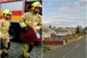 firefighters dispatched to pump out flooded residential street