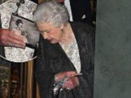 the queen carries a purse with image of princess margaret