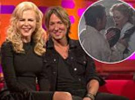 Nicole Kidman squirms next to her husband Keith Urban