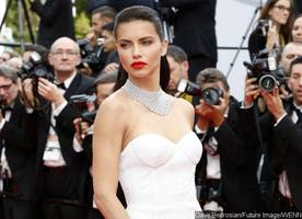 adriana lima's gown almost fails to protect her modesty at cannes
