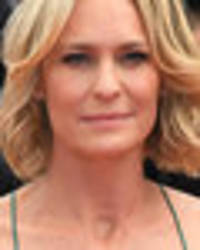 braless robin wright leaves cannes blushing as nipples upstage plunging gown