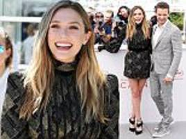 Elizabeth Olsen exhibits her legs at Wind River photocall