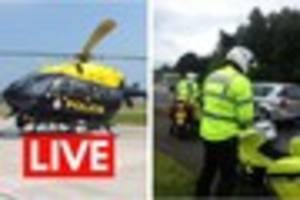 police helicopter above exeter to monitor major influx of traffic