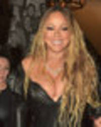 cleavage so big looks painful: mariah carey flaunts epic boobs in pvc