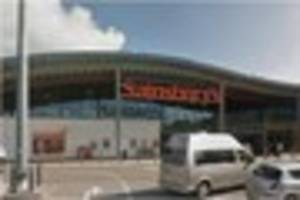 vandals tear off each illuminated letter of a devon sainsbury's...