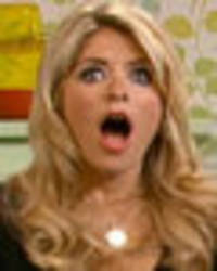 holly willoughby nearly reveals all in kinky french maid costume
