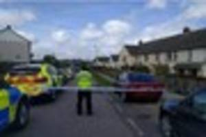 Police widen search in manhunt after armed robbery and cordon off...