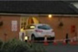 a car has crashed through some french doors and ended up inside a...