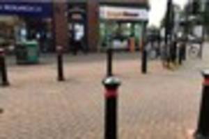 WATCH as hundreds of bees swarm in Station Street in Burton