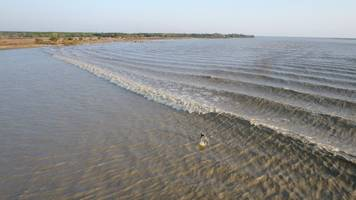 Surfers discover world class river wave in Myanmar