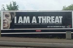 Large billboards calling Theresa May 'a threat' have been spotted in Cardiff