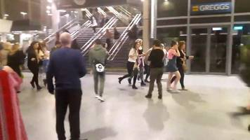 manchester arena: panic inside train station