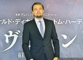 Leonardo DiCaprio Gets Flirty With Pretty Brunette During Guys' Night Out