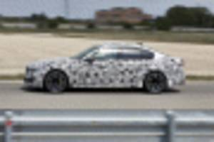 BMW racer Timo Glock gets acquainted with new M5's all-wheel-drive system