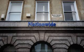nationwide's profits drop to £1bn following interest rate cuts