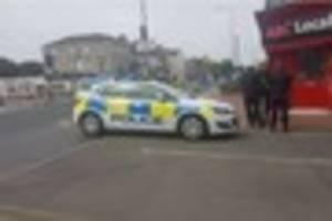 Man, 21, arrested over 'sexual assault' after armed police...
