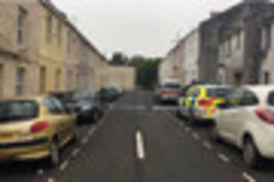 Plymouth street cordoned off by police