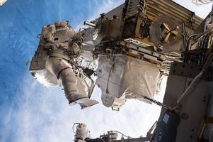 Astronauts carry out International Space Station relay box repairs