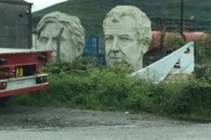 giant statues of jeremy clarkson and richard hammond have turned up at port talbot docks