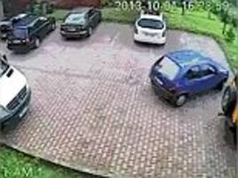 driver struggles to maneuver out of a parking space